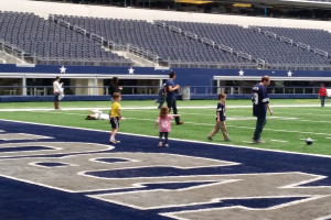 Xander, Maggie, Jason, and Kris in the end-zone at AT&T Stadium