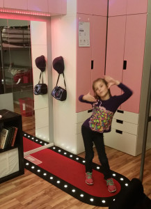 Annabelle posing in her dream room at Ikea